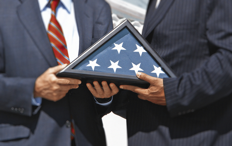 Men Holding Memorial Flag Case