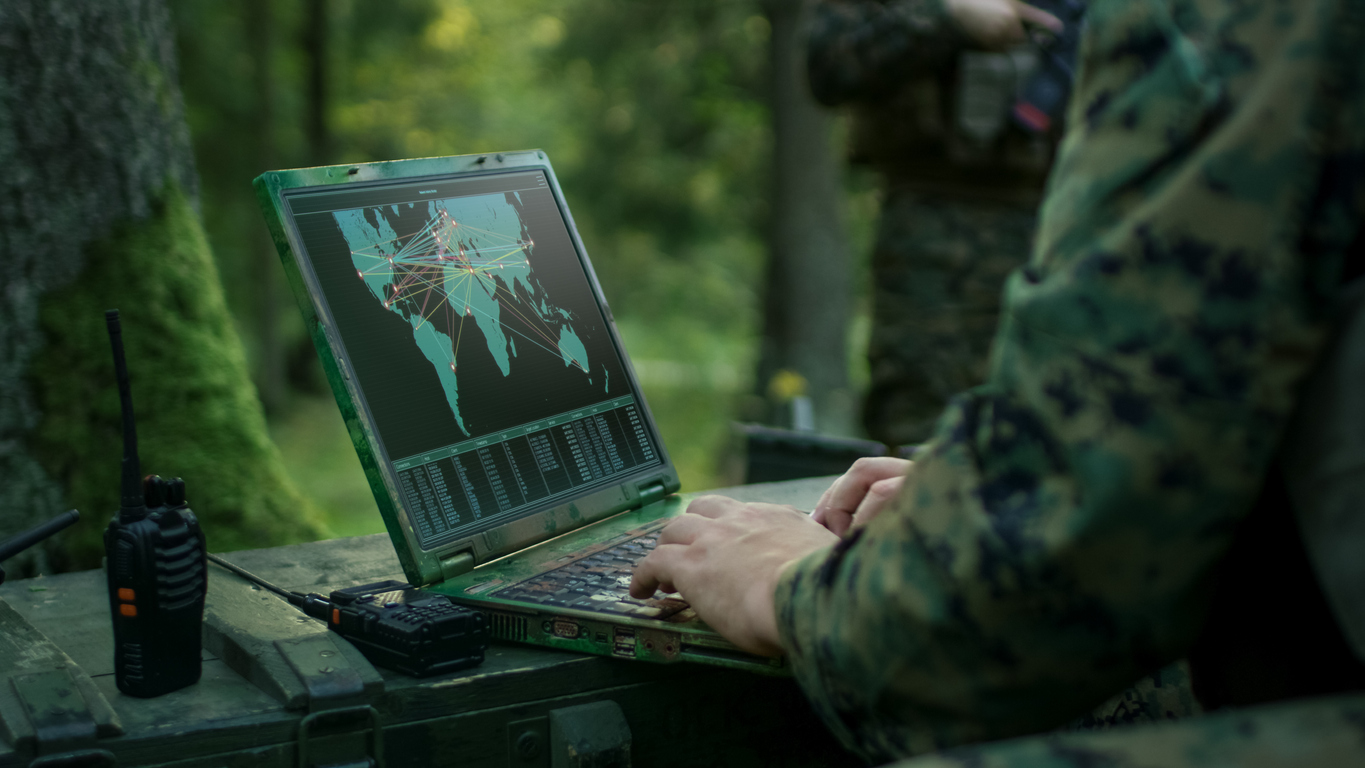Military Operation in Action, Soldiers Using Military Grade Laptop Targeting Enemy with Satellite.